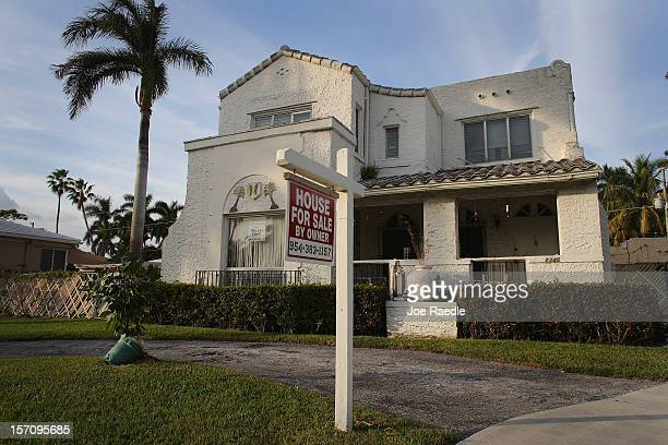 For Sale' sign is posted in front of a house on November 28, 2012 in Hollywood, Florida. According to S&P Index reports, for the month of September...