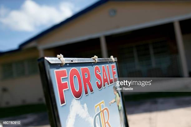 A for sale sign is seen in front of a home as the National Association of Realtors released numbers for November that showed sales of previously...