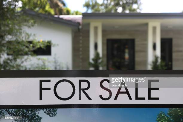 A 'for sale' sign is seen in front of a home on May 30 2019 in Miami Florida The National Association of Realtors announced that its pending home...