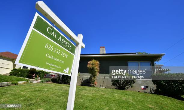 For sale sign is seen near a house for sale in South Pasadena, California on April 24, 2020. - The coronavirus pandemic has worsened the US housing...