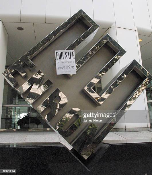 A ''For Sale'' sign left as a joke hangs on the corporate logo outside Enrons headquarters January 26 2002 in Houston Texas Enron now in bankruptcy...