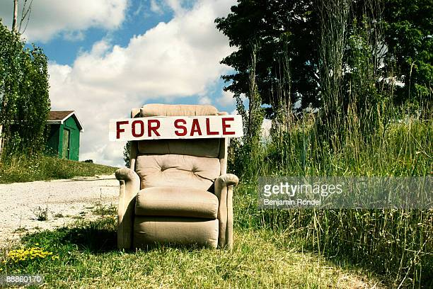For Sale sign on an old recliner chair