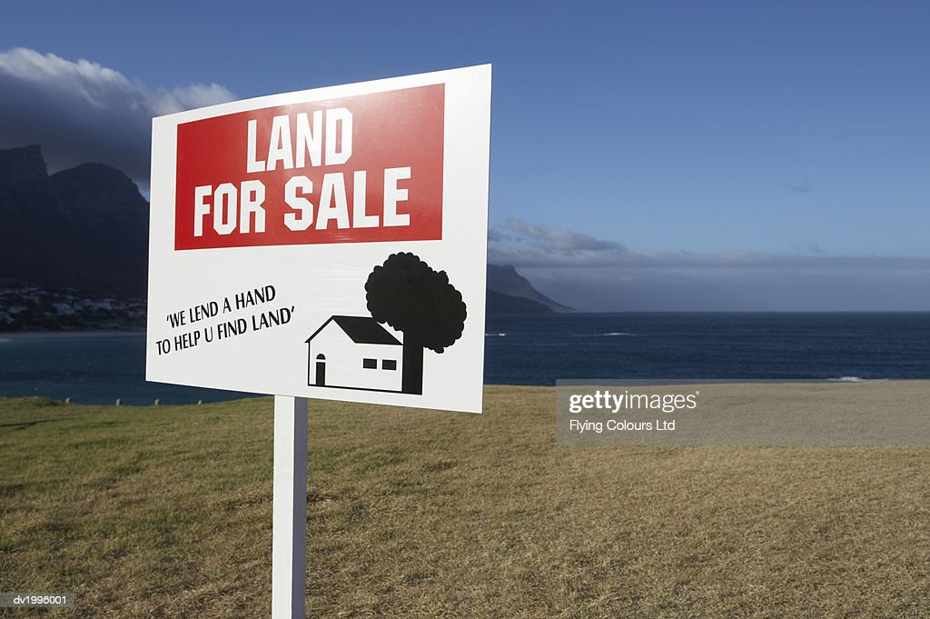 For Sale Sign on the Coast : Stock Photo