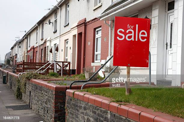 For sale sign outside UK terraced houses