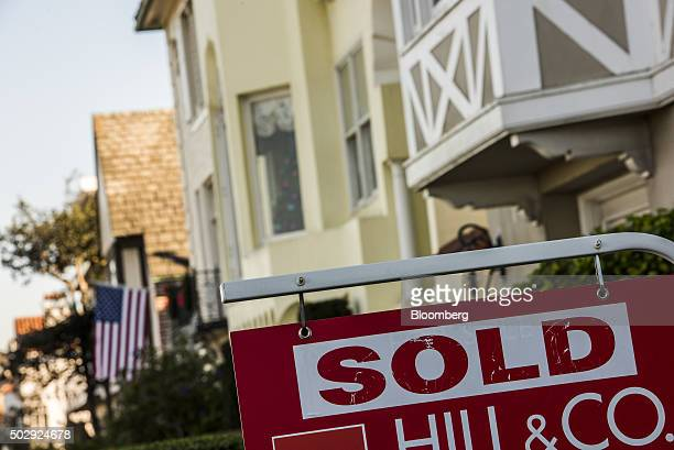 A 'For Sale' sign stands in front of a home in San Francisco California US on Tuesday Dec 29 2015 Home values in 20 US cities rose at a faster pace...