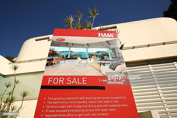 A 'For Sale' sign stands in front of a house in Sydney Australia on Thursday Aug 11 2016 Australia's central bank said inflation would remain low and...