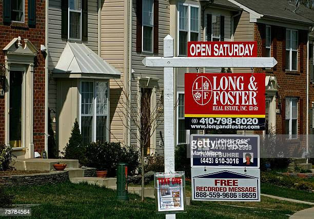 A for sale sign stands in front of a row of townhouses April 3 2007 in Chesapeake Beach Maryland Although the US stock market rose sharply today due...