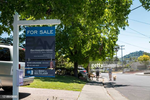 A For Sale sign stands in front of a single family home in San Rafael California US on Monday June 8 2020 Across the San Francisco Bay area home to...