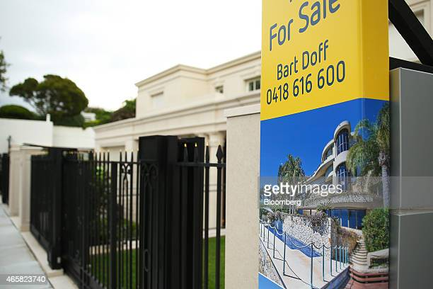 A 'for sale' sign stands on display outside a residential property in the suburb of Point Piper in Sydney Australia on Tuesday March 10 2015...