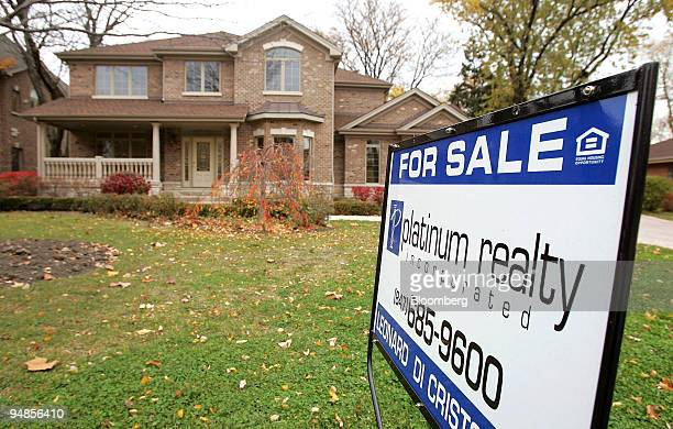 For sale sign stands outside a home in Park Ridge, Illinois, U.S., on Thursday, Nov. 6, 2008.
