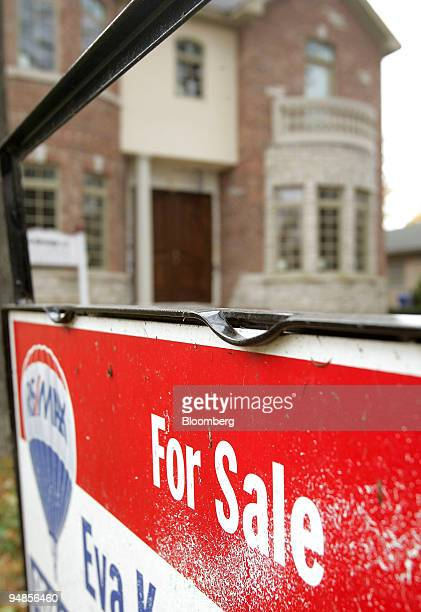 For sale sign stands outside a newly built home in Park Ridge, Illinois, U.S., on Thursday, Nov. 6, 2008.