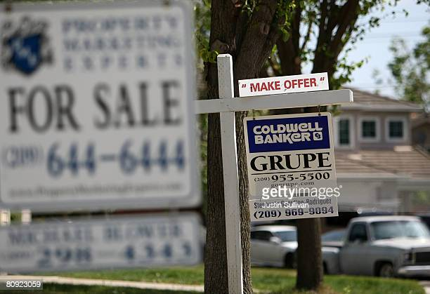 For sale signs are posted in front of homes for sale April 29, 2008 in Stockton, California. As the nation continues to see widespread home loan...