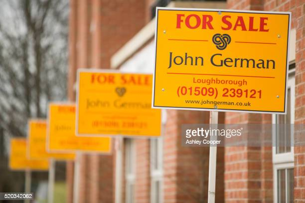 For Sale Signs on Row Houses