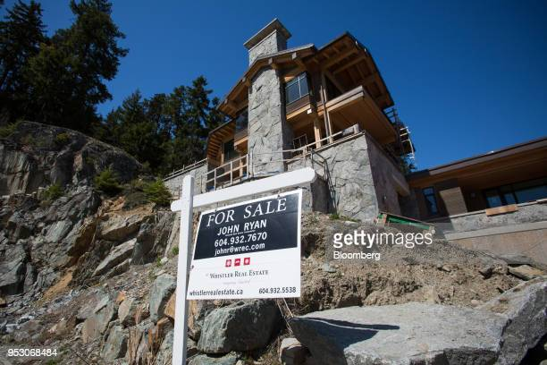 A 'For Sale' signs stands in front of a luxury home under construction on Treetop Lane in Whistler British Columbia Canada on Friday April 27 2018...