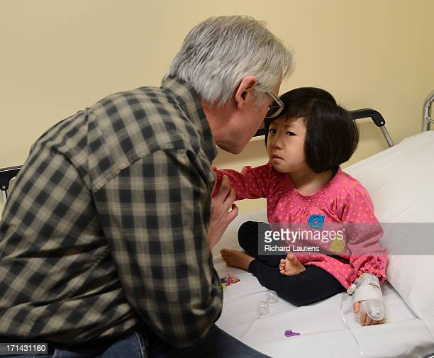For Sick Kids Special Section David has a quiet moment with Grace during her treatment Liz and David Turnbull adopted threeyearold Grace from China...
