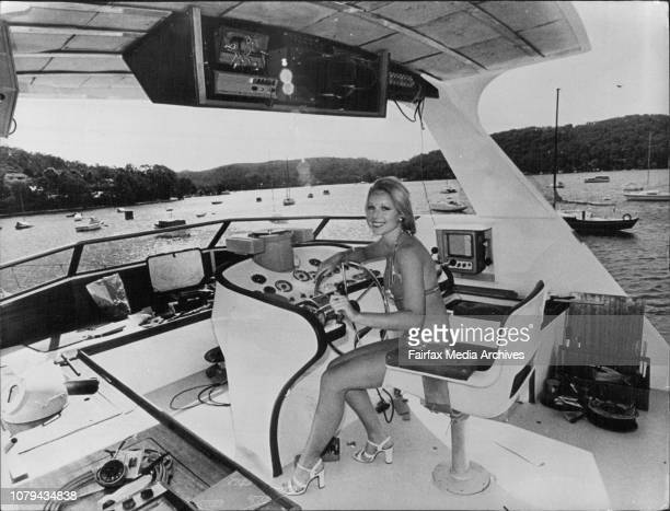 For special article by Lou D'AlpugetPretty Allison McKean 19 of Cremorne aboard the $500000 cruiser in Pittwater today August 29 1975