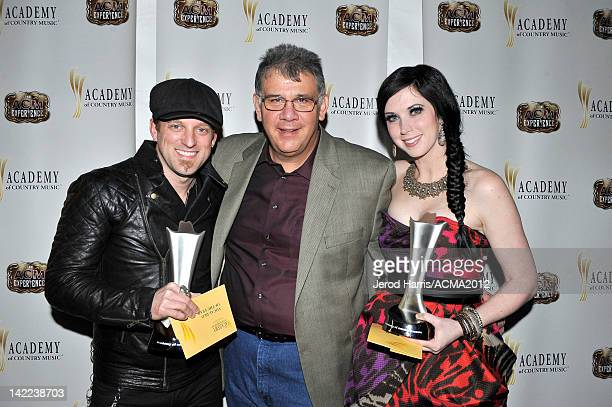 CEO for the Academy of Country Music Bob Romeo and Keifer Thompson and Shawna Thompson of the music duo Thompson Square pose with the award for Vocal...