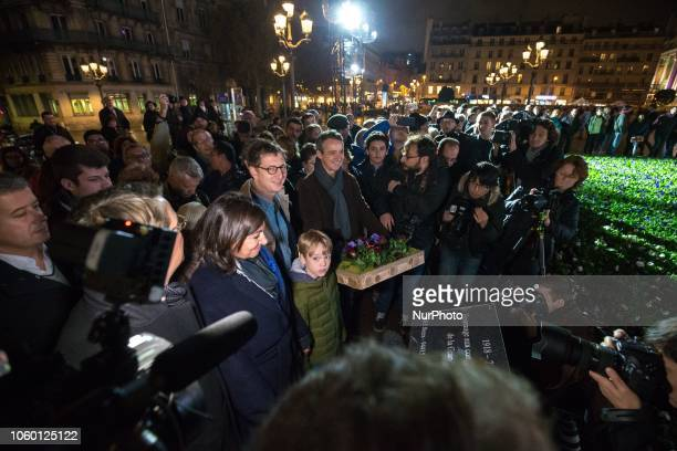 For the centenary of the Armistice of the First World War Paris Mayor Anne Hidalgo lays some flowers in front of Paris city hall assisted by children...