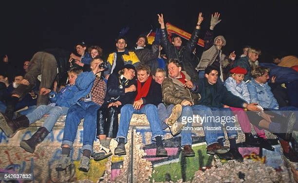 For the first time Germans celebrate New Year's eve on the Berlin wall which separated East and West Berlin