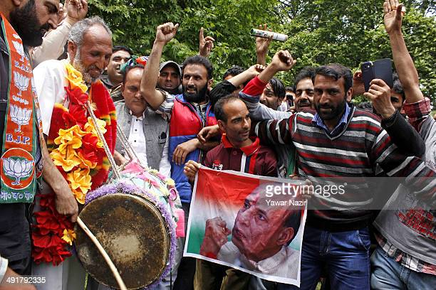 For the first time Kashmiri supporters of the Hindu nationalist Bharatiya Janata Party celebrate and dance after their victory in the Indian...