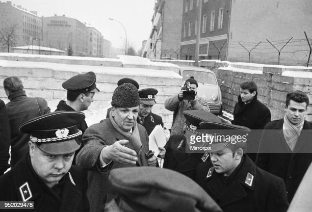 For the first time since its erection the Berlin Wall is opened for border crossings for 18 days over the Christmas period Many queued for passes to...