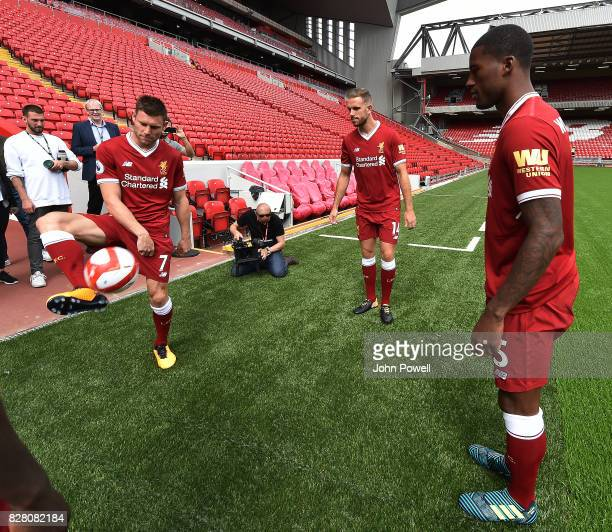 For the Launch of the Western Union partnership James Milner Jordan Henderson and Georginio Wijnaldum of Liverpool wear the shirts with the logo on...