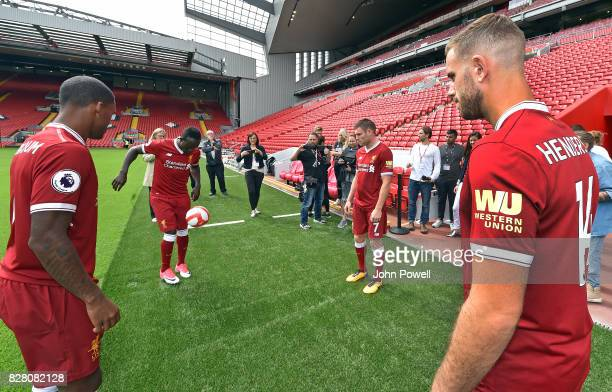 For the Launch of the Western Union partnership Sadio Mane James Milner Jordan Henderson and Georginio Wijnaldum of Liverpool wear the shirts with...