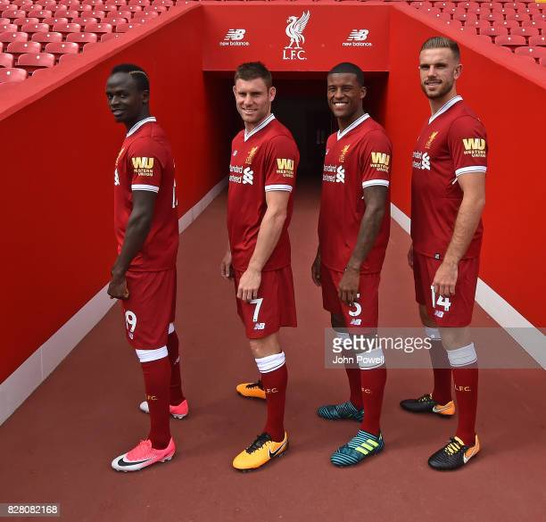 For the Launch of the Western Union partnership Sadio Mane James Milner Georginio Wijnaldum and Jordan Henderson of Liverpool wear the shirts with...
