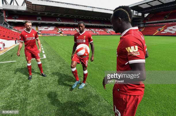 For the Launch of the Western Union partnership Sadio Mane Jordan Henderson and Georginio Wijnaldum of Liverpool wear the shirts with the logo on and...
