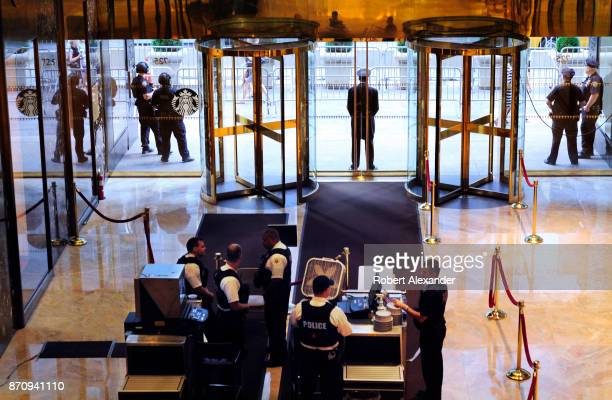 For the security of US President Donald Trump and his family officers from the New York Police Department and US Secret Service search the bags of...