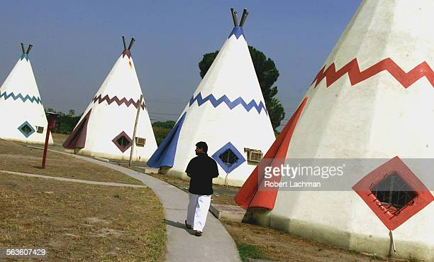 For the Surroundings column: Manish Patel, manager, walks along a path at the Wigwam Motel, which feature 20 teepee–style motel rooms along Foothill...