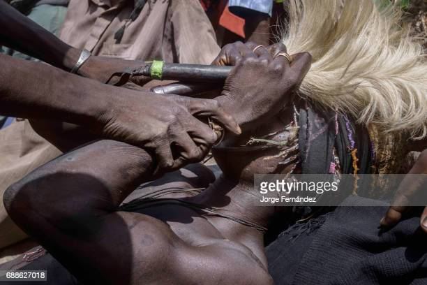 For the Yom tribe the circumcision ceremony is a very important rite of passage from boys to men The initiate lays down in the circumcision place...