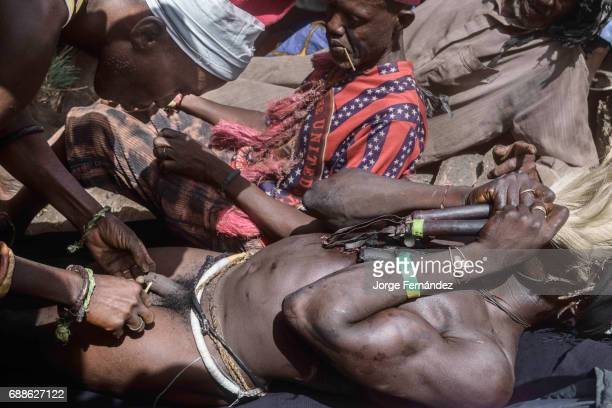 For the Yom tribe, the circumcision ceremony is a very important rite of passage from boys to men. The initiate lays down in the circumcision place,...