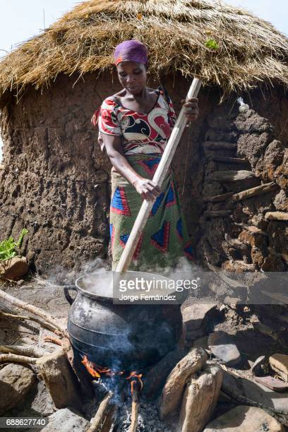 For the Yom tribe the circumcision ceremony is a very important rite of passage from boys to men Woman cooking a kind of soup in a big pot for the...