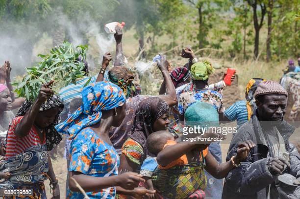 For the Yom tribe the circumcision ceremony is a very important rite of passage from boys to men The crowd enjoy the party dancing and throwing white...