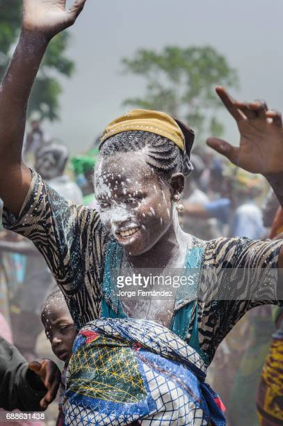 For the Yom tribe the circumcision ceremony is a very important rite of passage from boys to men Woman covered in white powder during the celebration...