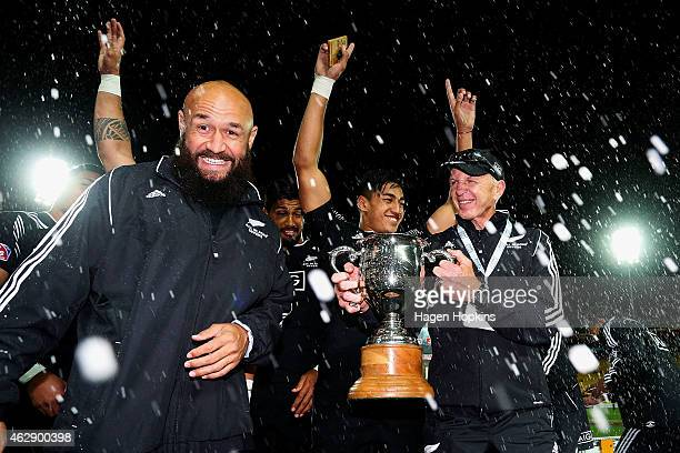 Forbes and coach Sir Gordon Tietjens celebrate after winning the cup final between England and New Zealand in the 2015 Wellington Sevens at Westpac...