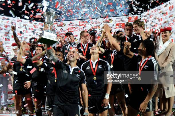 Forbes and New Zealand teammates celebrate with the trophy after the Cup final against England on day 2 of the HSBC Sevens World Series Emirates...
