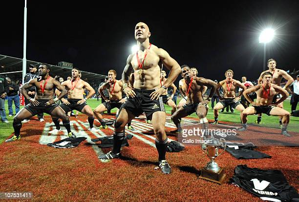 Forbes and New Zealand teammates do the Haka beside the trophy after winning the Cup final against England on day 2 of the HSBC Sevens World Series...