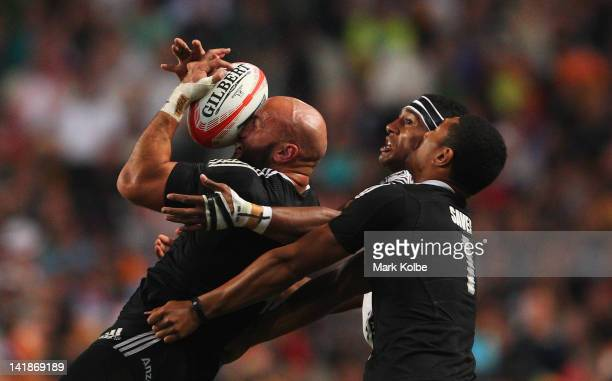 Forbes of New Zealand is hit in the face with the ball during the Cup Final match between Fiji and New Zealand on day three of the 2012 IRB Hong Kong...