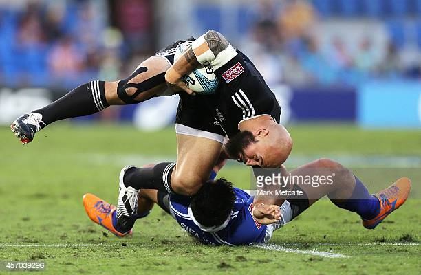 Forbes of New Zealand is tackled by Tofatuimoana Solia of Samoa during the 2014 Gold Coast Sevens Pool A match between New Zealand and Samoa at Cbus...
