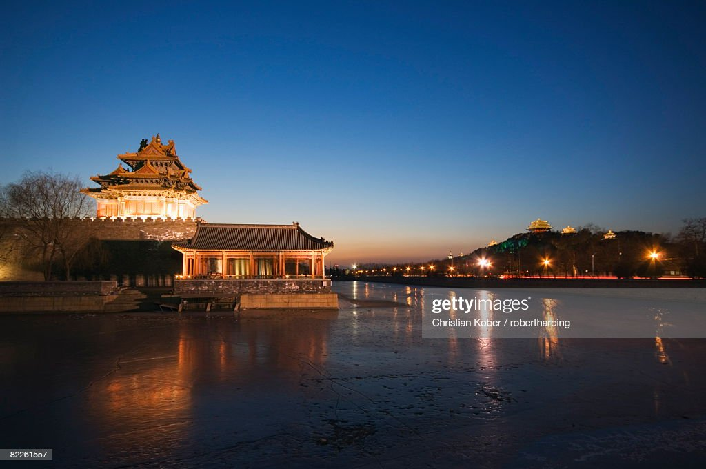 Forbidden City Palace Museum moat and Jingshan Park pavilions illuminated at night, UNESCO World Heritage Site, Beijing, China, Asia : Stock Photo