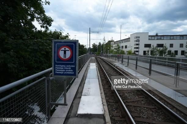 forbidden pedestrian sign and railroads at nidau, switzerland - 待避所標識 ストックフォトと画像