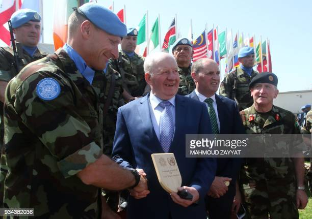 A Force Commander of the United Nations Interim Force in Lebanon honours retired soldier John Omahony during the UNIFLIS's 40th anniversary...