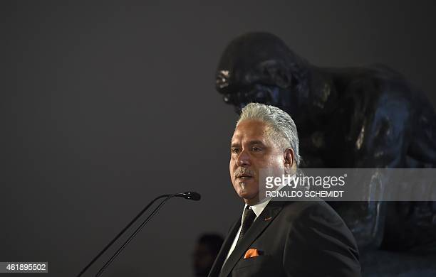 Force India Chairman Vijay Mallya delivers a speech next to a Force India Formula 1 Team car with the new team livery that will adorn their cars...