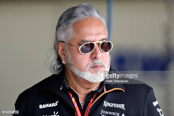 Force India Chairman Vijay Mallya looks on in the Pitlane during practice for the Formula One Grand Prix of Great Britain at Silverstone on July 14...