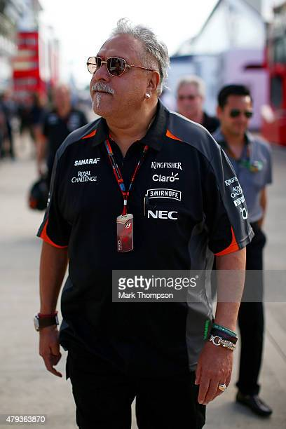 Force India Chairman Vijay Mallya walks in the paddock during practice for the Formula One Grand Prix of Great Britain at Silverstone Circuit on July...