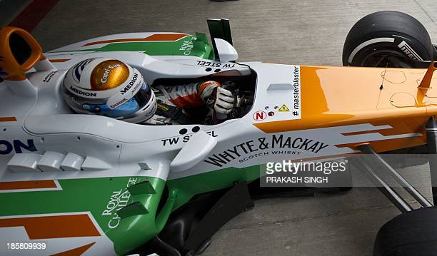 Force India driver Adrian Sutil of Germany drives his car during the second practice session at The Buddh International circuit in Greater Noida on...