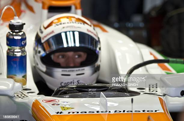 Force India driver Adrian Sutil of Germany gets ready with the Twitter hashtag '#masterblaster' on his car during the second practice session at The...