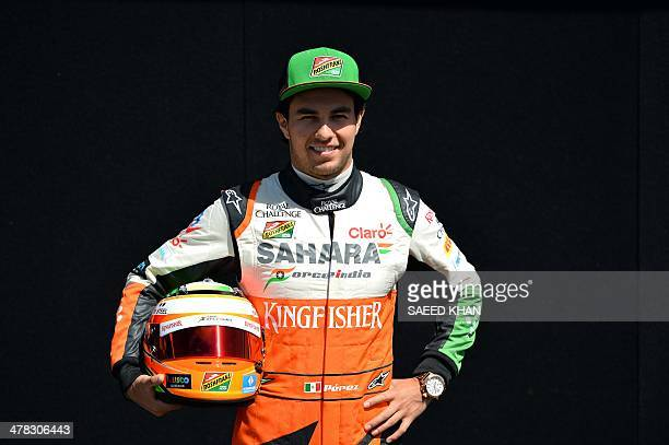 Force India driver Sergio Perez of Mexico poses during a photo shoot ahead of the Formula One Australian Grand Prix in Melbourne on March 13, 2014....